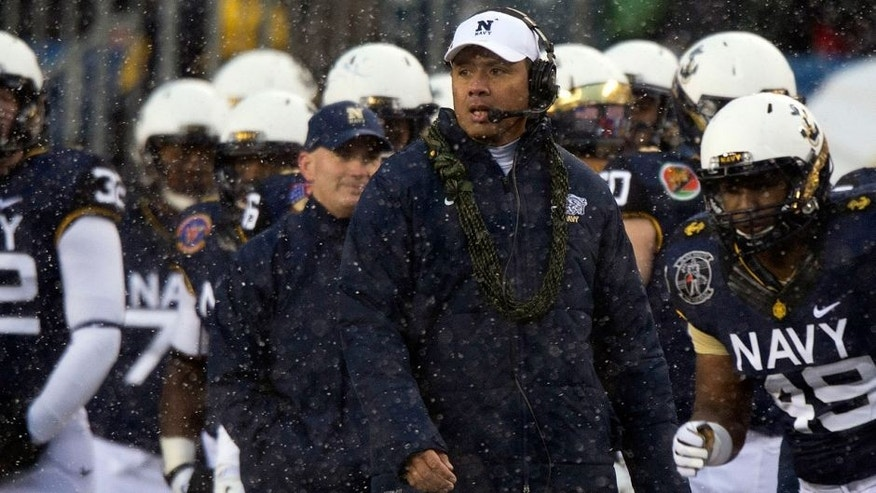 Dec 14, 2013; Philadelphia, PA, USA; Navy Midshipmen head coach Ken Niumatalolo reacts on the sidelines during first quarter of the 114th Army-Navy game at Lincoln Financial Field. Mandatory Credit: Tommy Gilligan-USA TODAY Sports