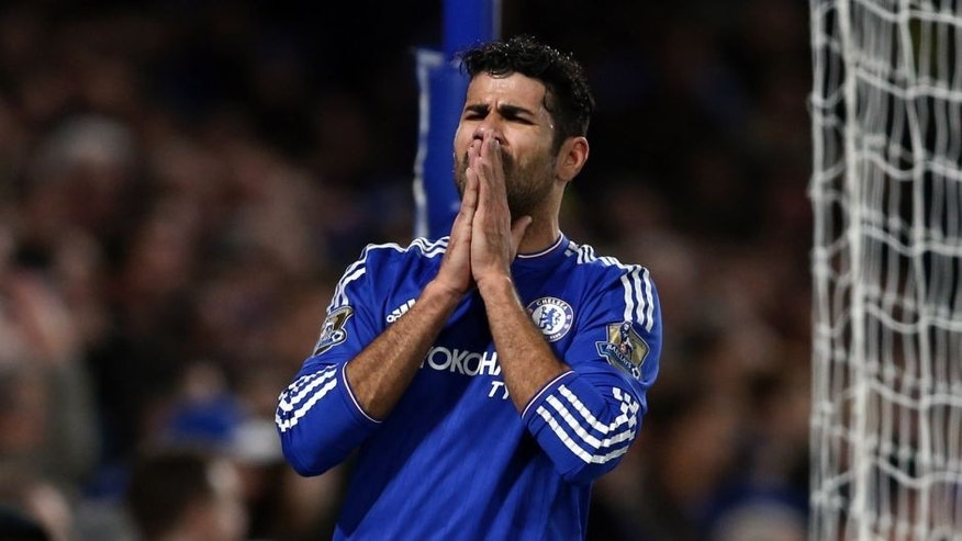 Chelsea's Brazilian-born Spanish striker Diego Costa reacts during the English Premier League football match between Chelsea and Bournemouth at Stamford Bridge in London on December 5, 2015. AFP PHOTO / JUSTIN TALLIS RESTRICTED TO EDITORIAL USE. No use with unauthorized audio, video, data, fixture lists, club/league logos or 'live' services. Online in-match use limited to 75 images, no video emulation. No use in betting, games or single club/league/player publications. / AFP / JUSTIN TALLIS (Photo credit should read JUSTIN TALLIS/AFP/Getty Images)