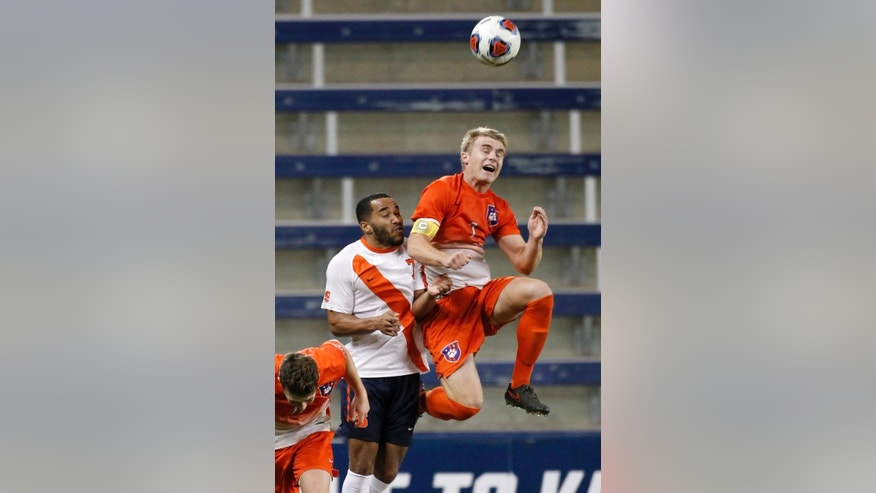 Clemson defender Kyle Fisher (2) heads the ball as Syracuse forward Ben Polk (7) defends in the first half of the NCAA College Cup soccer match, Friday, Dec. 11, 2015, in Kansas City, Kan. (AP Photo/Colin E. Braley)