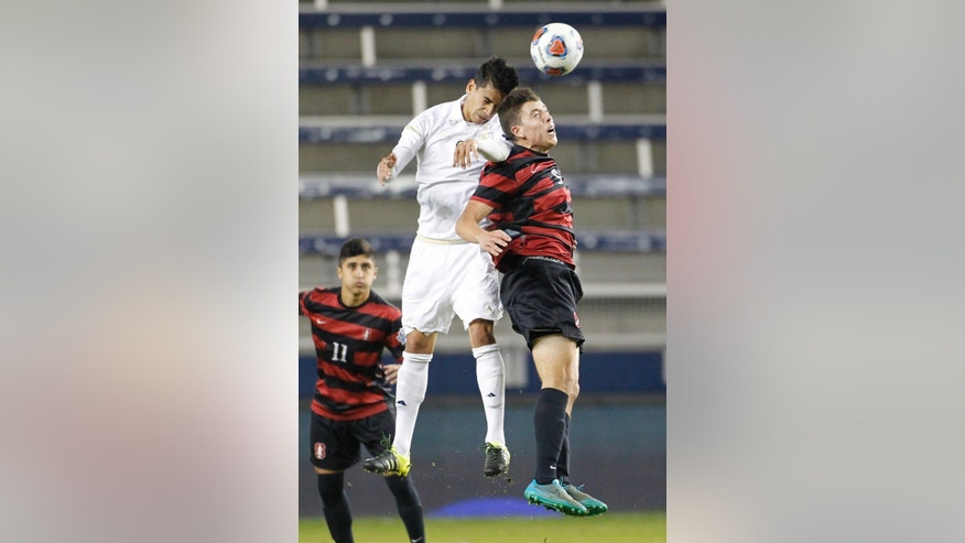 Akron's Victor Souto (8) and Stanford's Slater Meehan (5) head the ball as Stanford midfielder Amir Bashti (11) looks on in the first half of an NCAA College Cup soccer match, Friday, Dec. 11, 2015, in Kansas City, Kan. (AP Photo/Colin E. Braley)