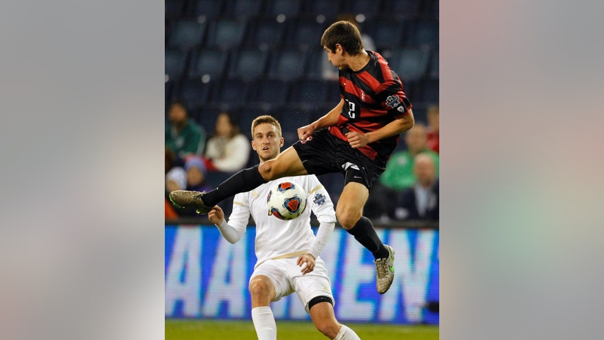 Stanford defender Drew Skundrich, right, clears the ball away from Akron forward Sam Gainford, left, in the first half of an NCAA College Cup soccer match, Friday, Dec. 11, 2015, in Kansas City, Kan. (AP Photo/Colin E. Braley)