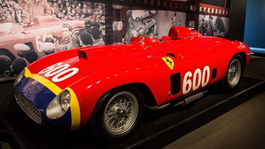"NEW YORK, NY - DECEMBER 04: A 1956 Ferrari 290 MM by Scaglietti sits on display at Sotheby's during a press preview before the ""Driven by Disruption"" auction on December 4, 2015 in New York City. The auction will include more than 30 vehicles spanning 70 years in automotive innovation. (Photo by Andrew Burton/Getty Images)"