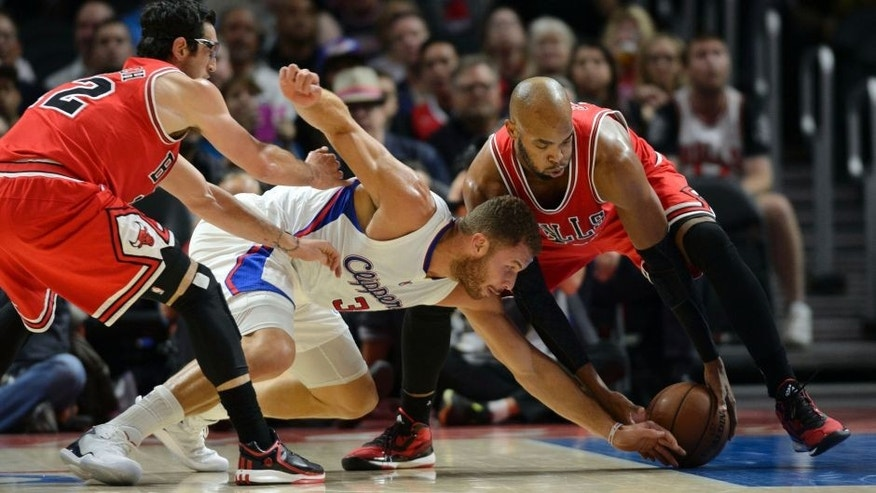 Nov 17, 2014; Los Angeles, CA, USA; Los Angeles Clippers forward Blake Griffin (32) and Chicago Bulls forward Taj Gibson (22) battle for the loose ball during the first quarter at Staples Center. Mandatory Credit: Kelvin Kuo-USA TODAY Sports