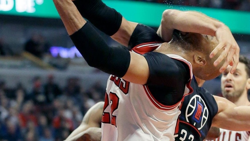 Los Angeles Clippers forward Blake Griffin (32) fouls Chicago Bulls forward Taj Gibson during the second half of an NBA basketball game on Thursday, Dec. 10, 2015, in Chicago. (AP Photo/Nam Y. Huh)