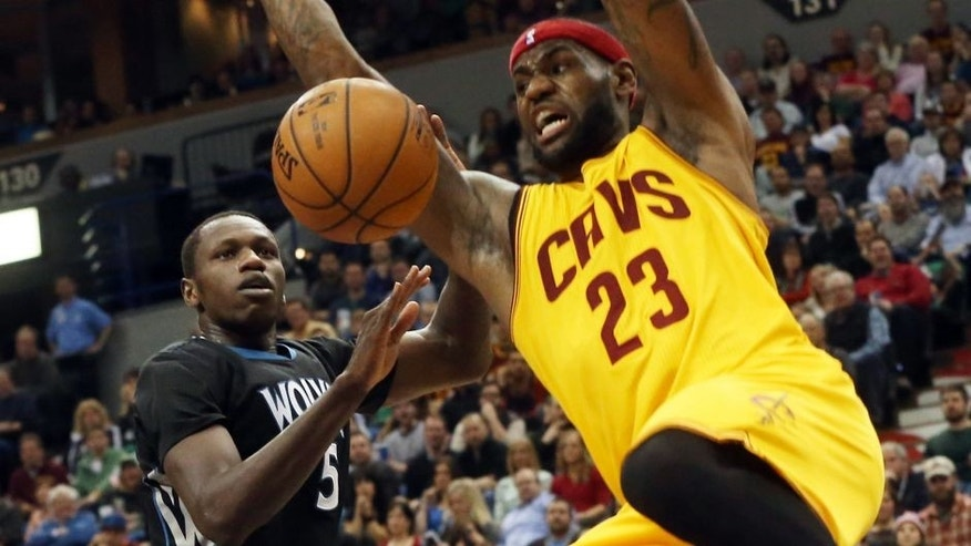 Cleveland Cavaliers's LeBron James, right, dunks in front of Minnesota Timberwolves' Gorgui Dieng of Senegal in the second half of an NBA basketball game, Saturday, Jan. 31, 2015, in Minneapolis. The Cavaliers won 106-90. James led the Cavaliers with 36 points. (AP Photo/Jim Mone),Cleveland Cavaliers's LeBron James, right, dunks in front of Minnesota Timberwolves' Gorgui Dieng of Senegal in the second half of an NBA basketball game, Saturday, Jan. 31, 2015, in Minneapolis. The Cavaliers won 106-90. James led the Cavaliers with 36 points. (AP Photo/Jim Mone)