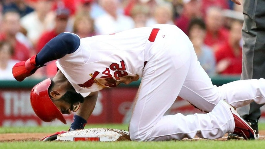 The St. Louis Cardinals' Jason Heyward pounds on the dirt after being thrown out trying to advance from first to third on a single by Yadier Molina in the first inning against the Pittsburgh Pirates on Thursday, Aug. 13, 2015, at Busch Stadium in St. Louis. The Pirates won, 10-5. (Chris Lee/St. Louis Post-Dispatch/TNS via Getty Images)