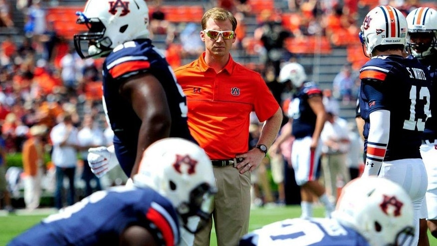 Aug 30, 2014; Auburn, AL, USA; Auburn Tigers offensive coordinator Rhett Lashlee during warm-ups prior to the game against the Arkansas Razorbacks at Jordan Hare Stadium. Mandatory Credit: Shanna Lockwood-USA TODAY Sports