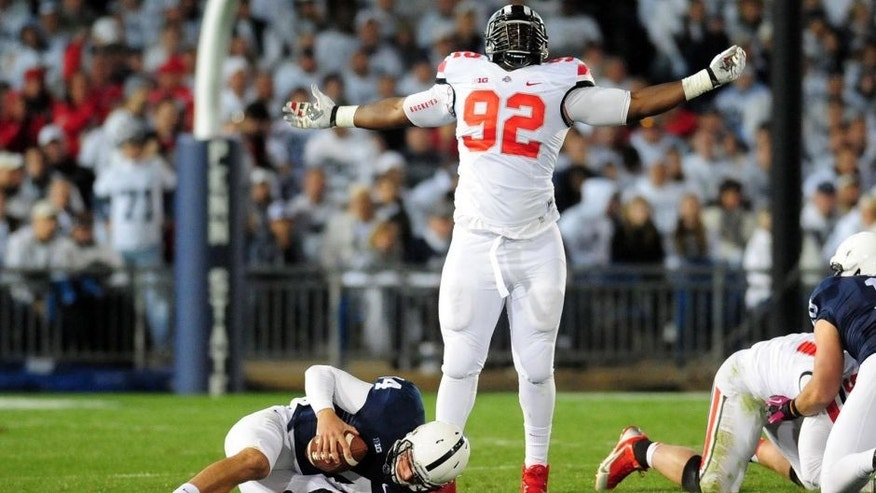 Oct 25, 2014; University Park, PA, USA; Ohio State Buckeyes defensive lineman Adolphus Washington (92) celebrates after sacking Penn State Nittany Lions quarterback Christian Hackenberg (14) in the fourth quarter at Beaver Stadium. Mandatory Credit: Evan Habeeb-USA TODAY Sports