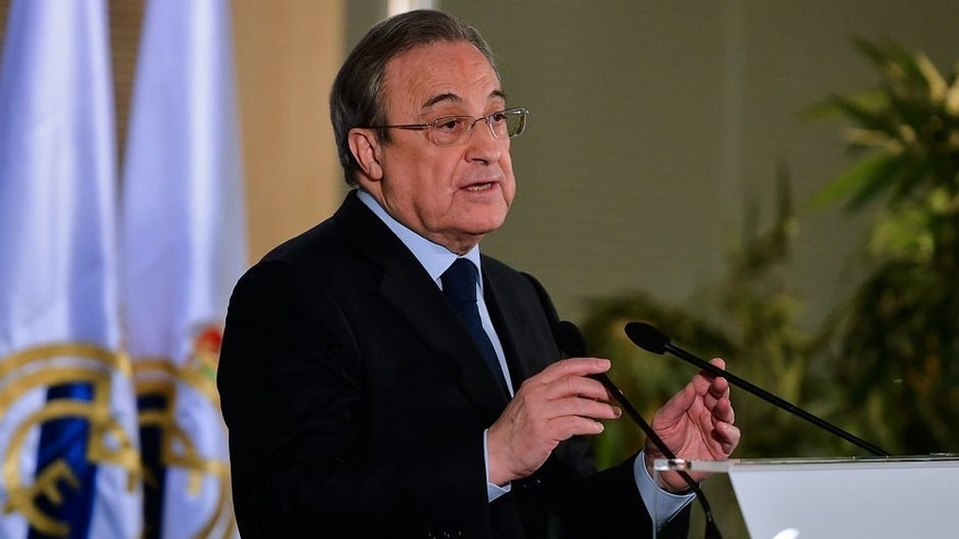 Real Madrid's president Florentino Perez gestures during a press conference at the Santiago Bernabeu stadium in Madrid on December 3, 2015, a day after the team fielded a suspended player during a match against Cadiz. Real Madrid edged closer to the Spanish Cup exit door today after third divison Cadiz appealed their midweek cup defeat because the capital giants had inadvertently fielded Russian international Denis Cheryshev, a move that last season saw second division Osasuna booted out of the cup in an almost identical case. AFP PHOTO/ PIERRE-PHILIPPE MARCOU / AFP / PIERRE-PHILIPPE MARCOU (Photo credit should read PIERRE-PHILIPPE MARCOU/AFP/Getty Images)