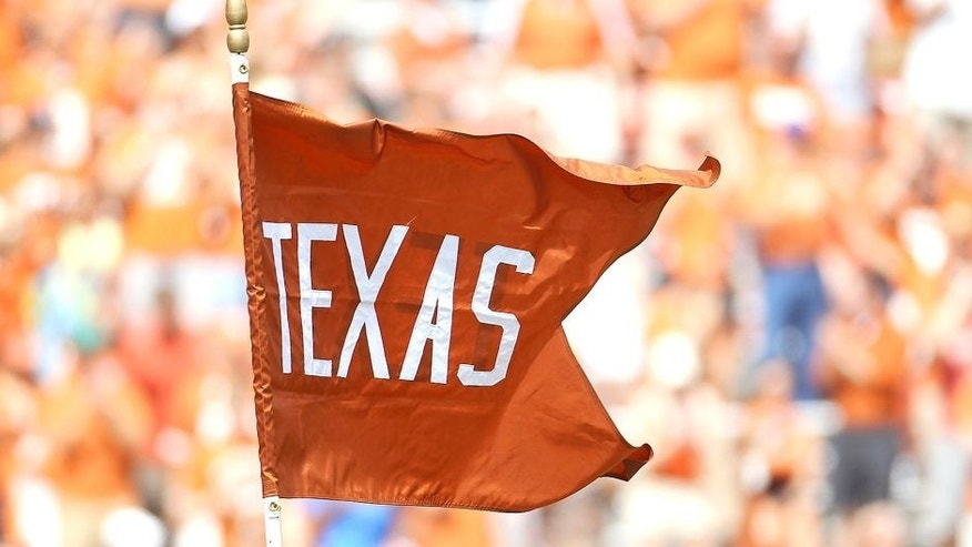 AUSTIN, TX - SEPTEMBER 25: A flag for the Texas Longhorns waves at Darrell K Royal-Texas Memorial Stadium on September 25, 2010 in Austin, Texas. (Photo by Ronald Martinez/Getty Images)