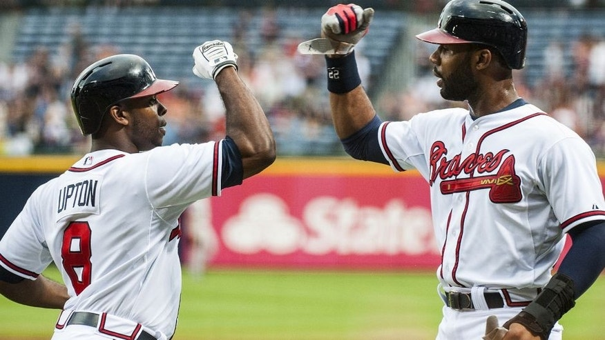 "<p style=""font-family: tahoma, arial, helvetica, sans-serif; font-size: 12px;"">ATLANTA, GA - AUGUST 1: Justin Upton #8 and Jason Heyward #22 of the Atlanta Braves celebrate during action against the Colorado Rockies at Turner Field on August 1, 2013 in Atlanta, Georgia. The Braves won 11-2. (Photo by Pouya Dianat/Atlanta Braves/Getty Images)</p>"