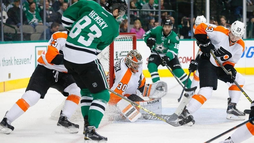 Dallas Stars' Ales Hemsky (83), of the Czech Republic, has his shot blocked by Philadelphia Flyers goalie Michal Neuvirth (30), also of the Czech Republic, as Brandon Manning (23) and Shayne Gostisbehere (53) help defend on the play in the first period of an NHL hockey game, Friday, Dec. 11, 2015, in Dallas. (AP Photo/Tony Gutierrez)