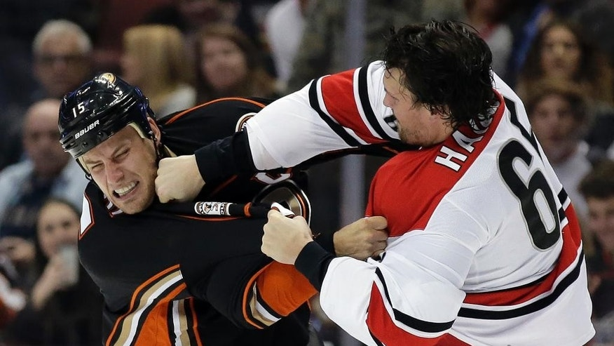 Carolina Hurricanes defenseman Ron Hainsey, brawls with Anaheim Ducks center Ryan Getzlaf during the second period of an NHL hockey game in Anaheim, Calif., Friday, Dec. 11, 2015. (AP Photo/Chris Carlson)