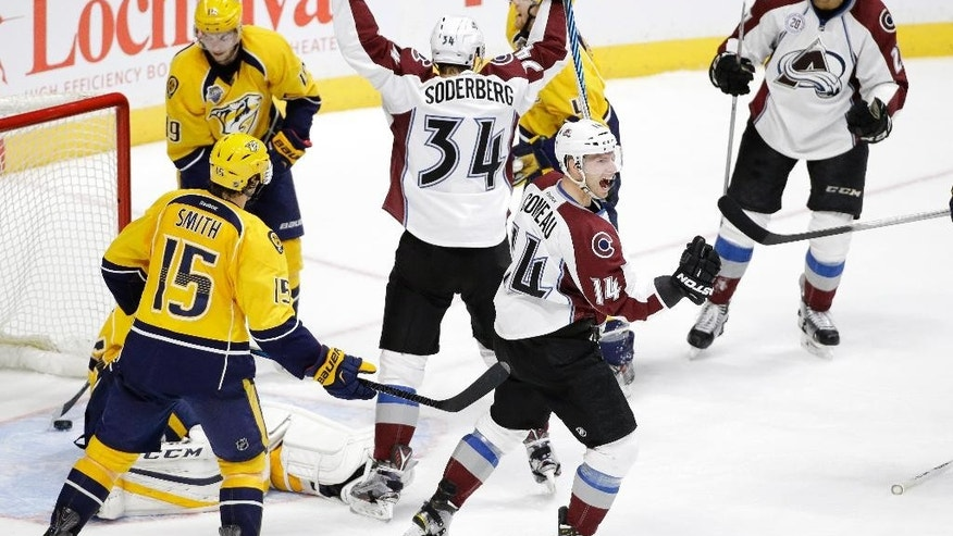 Colorado Avalanche left wing Andreas Martinsen, of Norway, upper right, celebrates with Carl Soderberg (34), of Sweden, and Blake Comeau (14) after Martinsen scored a goal against the Nashville Predators in the third period of an NHL hockey game Saturday, Dec. 12, 2015, in Nashville, Tenn. (AP Photo/Mark Humphrey)