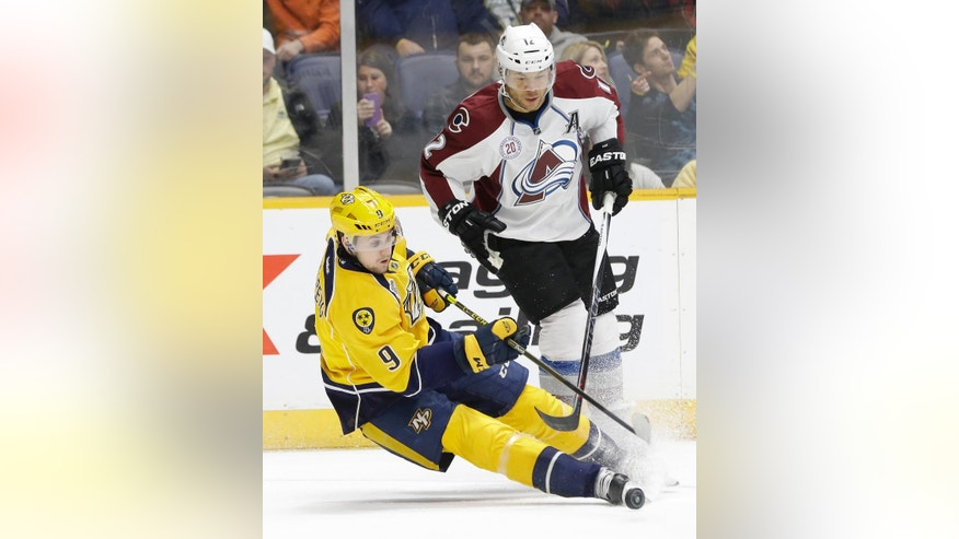 Nashville Predators center Filip Forsberg (9), of Sweden, falls as he battles Colorado Avalanche right wing Jarome Iginla (12) for the puck in the second period of an NHL hockey game Saturday, Dec. 12, 2015, in Nashville, Tenn. Iginla was called for hooking on the play. (AP Photo/Mark Humphrey)