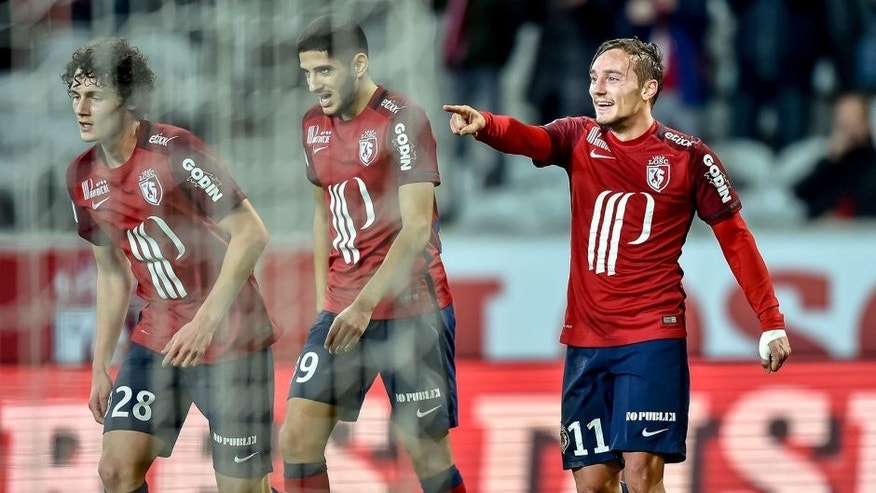 Lille's French midfielder Eric Bautheac (R) celebrates with teammates after scoring a goal during the French L1 football match between Lille OSC and FC Lorient on December 12, 2015 at the Pierre Mauroy Stadium in Villeneuve d'Ascq, northern France. AFP PHOTO / PHILIPPE HUGUEN / AFP / PHILIPPE HUGUEN (Photo credit should read PHILIPPE HUGUEN/AFP/Getty Images)