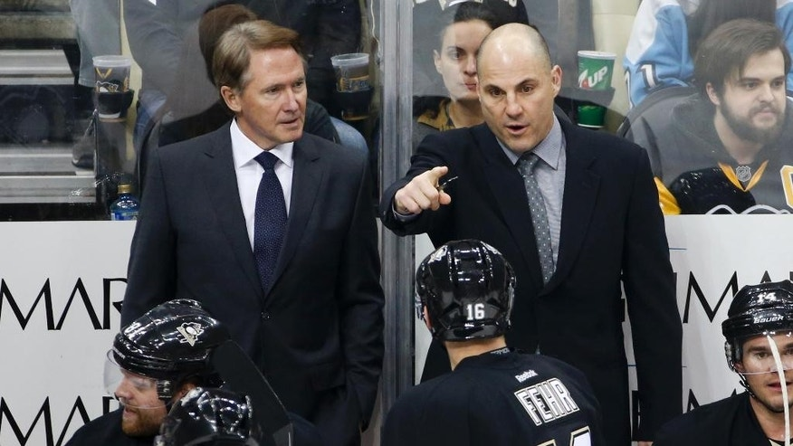 Pittsburgh Penguins' Mike Johnston, left, listens to assistant coach Rick Tocchet as he gives instructions during an NHL hockey game against the Los Angeles Kings in Pittsburgh Friday, Dec. 11, 2015. The Kings won 3-2 in a shootout. (AP Photo/Gene J. Puskar)