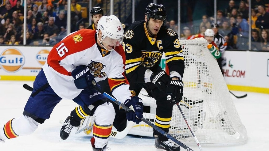 Florida Panthers' Aleksander Barkov (16) and Boston Bruins' Zdeno Chara (33) battle for the puck during the first period of an NHL hockey game in Boston, Saturday, Dec. 12, 2015. (AP Photo/Michael Dwyer)