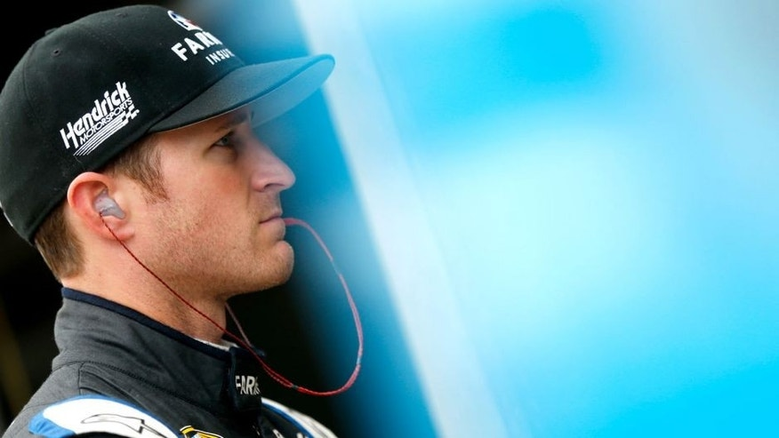 FORT WORTH, TX - NOVEMBER 06: Kasey Kahne, driver of the #5 Farmers Insurance Chevrolet, stands in the garage area during practice for the NASCAR Sprint Cup Series AAA Texas 500 at Texas Motor Speedway on November 6, 2015 in Fort Worth, Texas. (Photo by Brian Lawdermilk/Getty Images for Texas Motor Speedway)