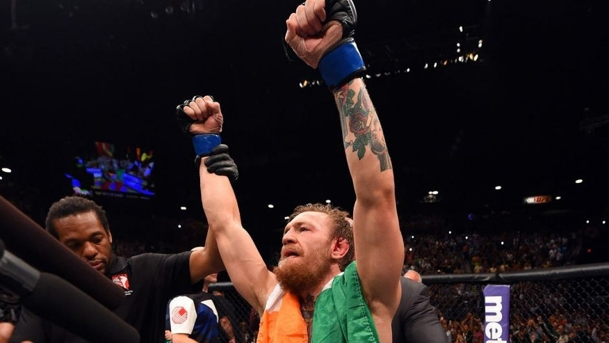 LAS VEGAS, NV - JULY 11: Conor McGregor reacts to his victory in their UFC interim featherweight title fight during the UFC 189 event inside MGM Grand Garden Arena on July 11, 2015 in Las Vegas, Nevada. (Photo by Josh Hedges/Zuffa LLC/Zuffa LLC via Getty Images)