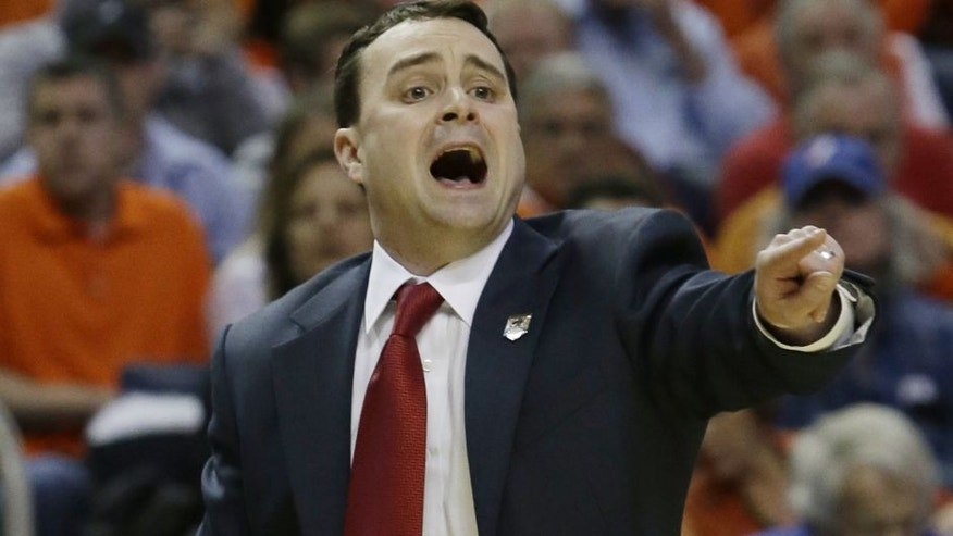 Dayton coach Archie Miller calls out to his team during the first half of a third-round game against Syracuse in the NCAA men's college basketball tournament in Buffalo, N.Y., Saturday, March 22, 2014. (AP Photo/Nick LoVerde)