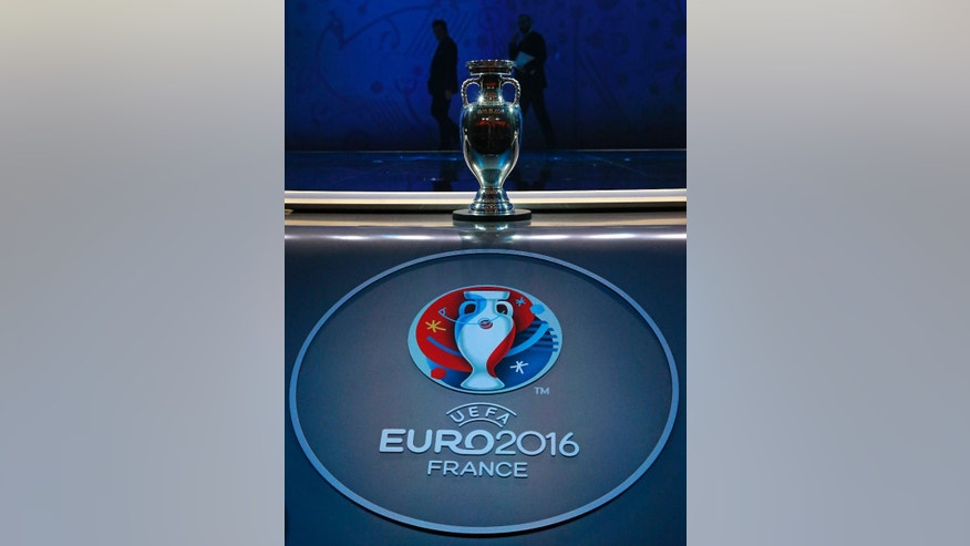 The European soccer championships trophy is put on display before the Euro 2016 draw in Paris Saturday, Dec. 12, 2015.  (AP Photo/Michel Euler)