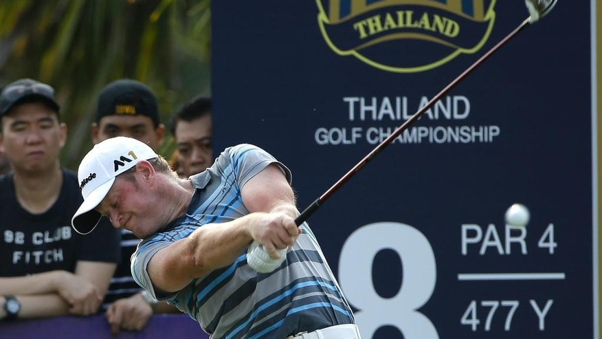 Jamie Donaldson of Wales hits off the 18th tee during the final round of the Thailand Golf Championship at the Amata Spring Country Club, Chonburi, Thailand, Sunday, Dec. 13, 2015. (AP Photo/Mark Baker)
