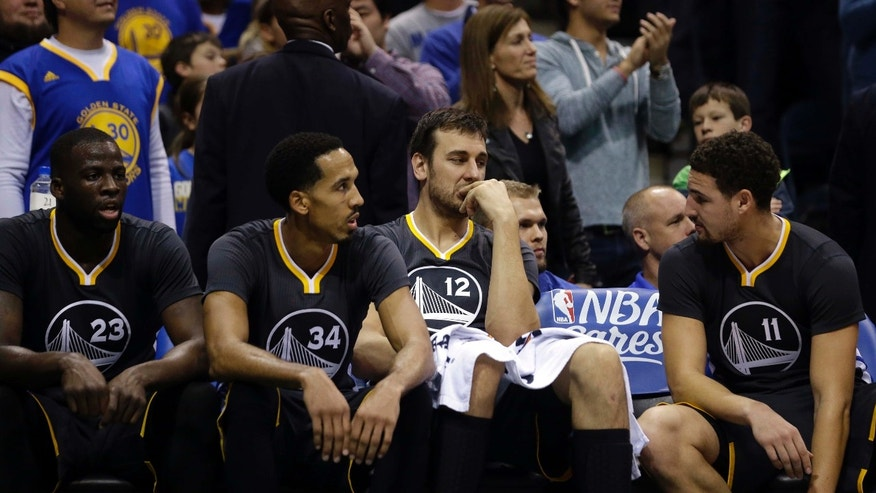 Dec. 12, 2015: Golden State Warriors' Andrew Bogut (12), Klay Thompson (11), Shaun Livingston (34), and Draymond Green (23) talk on the bench during the second half of an NBA basketball game against the Milwaukee Bucks