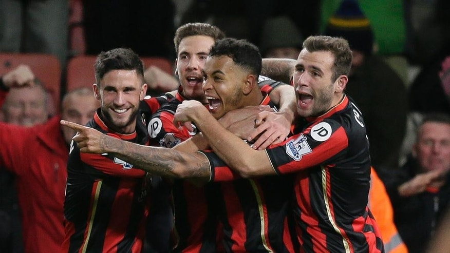 Bournemouth's Joshua King, centre, celebrates after scoring a goal during the English Premier League soccer match between Bournemouth and Manchester United at the Vitality Stadium in Bournemouth, England, Saturday Dec. 12, 2015. (AP Photo/Tim Ireland)