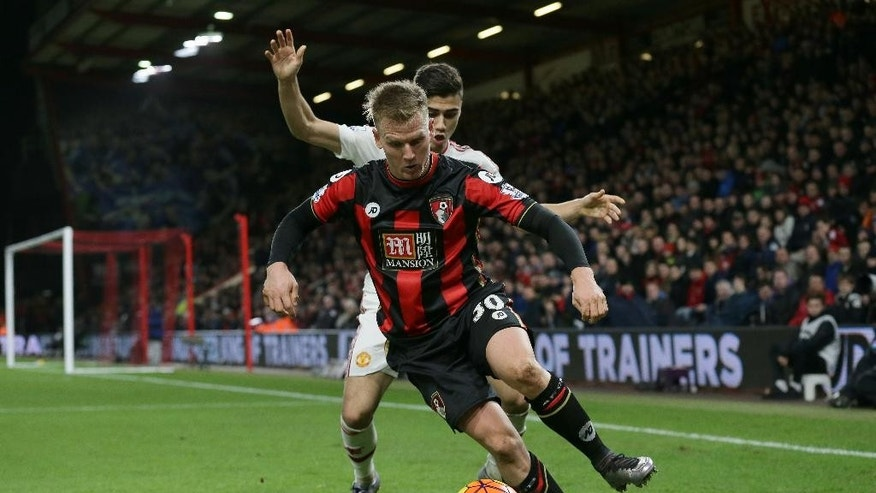 Bournemouth's Matt Ritchie, foreground,  competes for the ball with Manchester United's Andreas Pereira during the English Premier League soccer match between Bournemouth and Manchester United at the Vitality Stadium in Bournemouth, England, Saturday Dec. 12, 2015. (AP Photo/Tim Ireland)