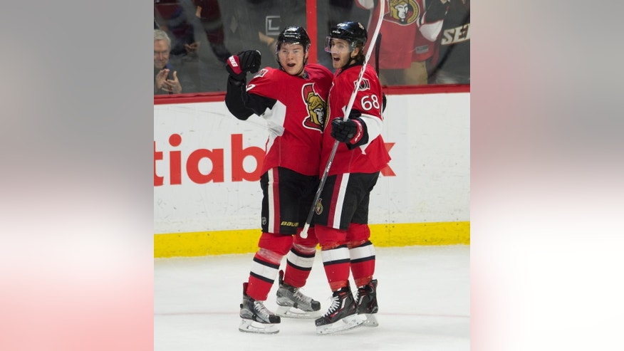 Ottawa Senators left wing Mike Hoffman, right, celebrates his second goal of the game with teammate right wing Curtis Lazar during the second period of an NHL hockey game in Ottawa, Ontario, Monday, Dec. 14, 2015. (Adrian Wyld/The Canadian Press via AP) MANDATORY CREDIT