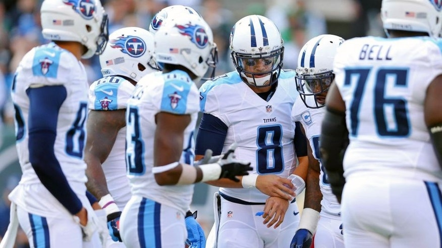 Dec 13, 2015; East Rutherford, NJ, USA; Tennessee Titans quarterback Marcus Mariota (8) in the huddle against the New York Jets during the first quarter at MetLife Stadium. Mandatory Credit: Brad Penner-USA TODAY Sports