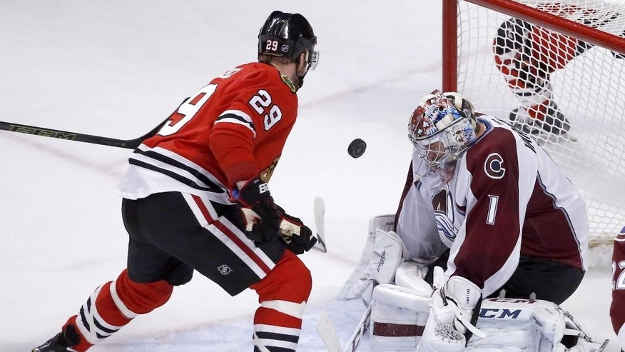 Colorado Avalanche goalie Semyon Varlamov (1) makes as save on a point black shot by Chicago Blackhawks left wing Bryan Bickell during the second period of an NHL hockey game Tuesday, Dec. 15, 2015, in Chicago. (AP Photo/Charles Rex Arbogast)