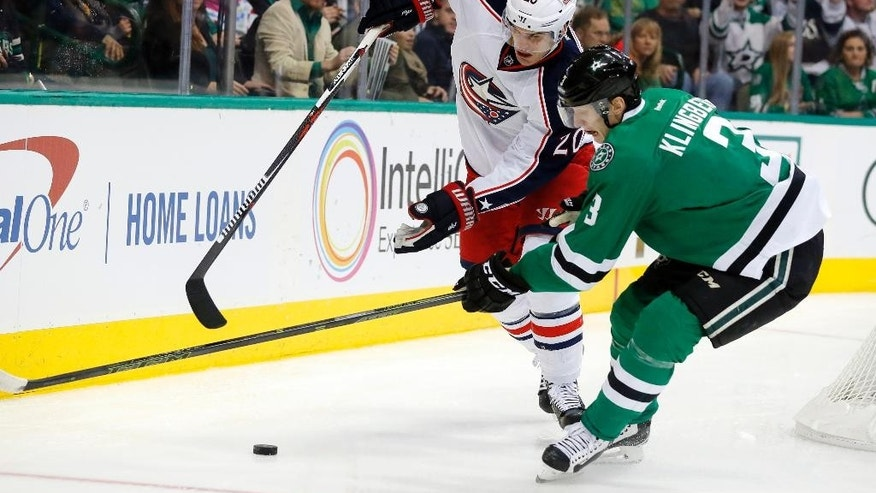Columbus Blue Jackets' Brandon Saad (20) challenges Dallas Stars defenseman John Klingberg (3) for control of the puck during the second period of an NHL hockey game, Tuesday, Dec. 15, 2015, in Dallas. (AP Photo/Tony Gutierrez)