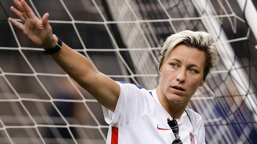 U.S. forward Abby Wambach waves to fans at the end of a practice session Tuesday, Dec. 15, 2015, in New Orleans for Wednesday's final U.S. victory tour match, against China. Wambach will be playing in her final match with the team. (AP Photo/Gerald Herbert)