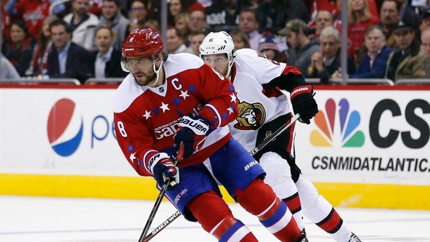 Washington Capitals left wing Alex Ovechkin (8), from Russia, skates with the puck with Ottawa Senators right wing Bobby Ryan (6) behind, during the second period of an NHL hockey game Wednesday, Dec. 16, 2015, in Washington. (AP Photo/Alex Brandon)