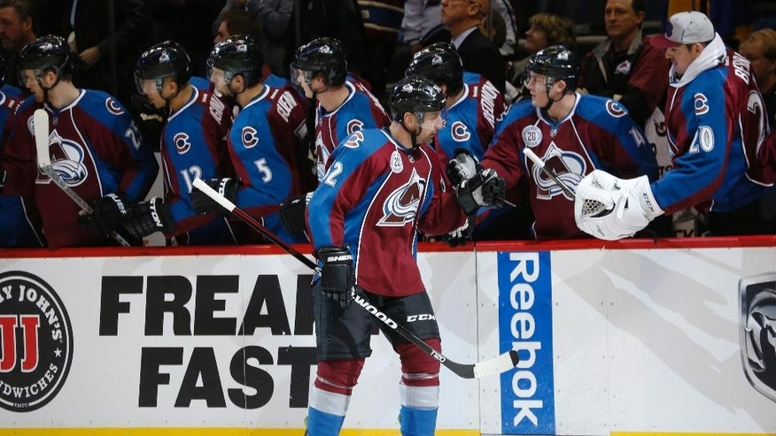 Colorado Avalanche defenseman Francois Beauchemin, front, is congratulated after scoring a goal against the New York Islanders in the first period of an NHL hockey game, Thursday, Dec. 17, 2015, in Denver. (AP Photo/David Zalubowski)