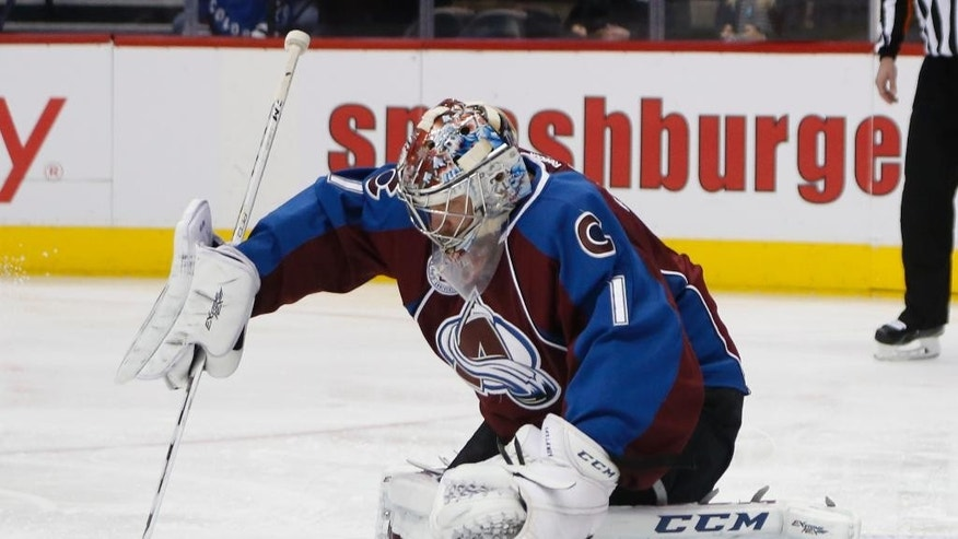 Colorado Avalanche goalie Semyon Varlamov, of Russia, makes a stick save of a shot against the New York Islanders in the first period of an NHL hockey game, Thursday, Dec. 17, 2015, in Denver. (AP Photo/David Zalubowski)