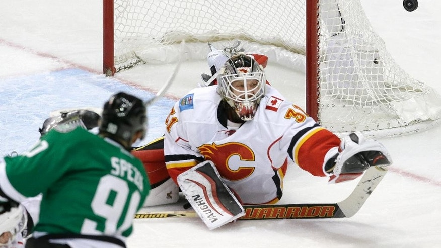 Calgary Flames goalie Karri Ramo (31) defends the goal against Dallas Stars center Jason Spezza (90) during the second period of an NHL hockey game Thursday, Dec. 17, 2015, in Dallas. (AP Photo/LM Otero)