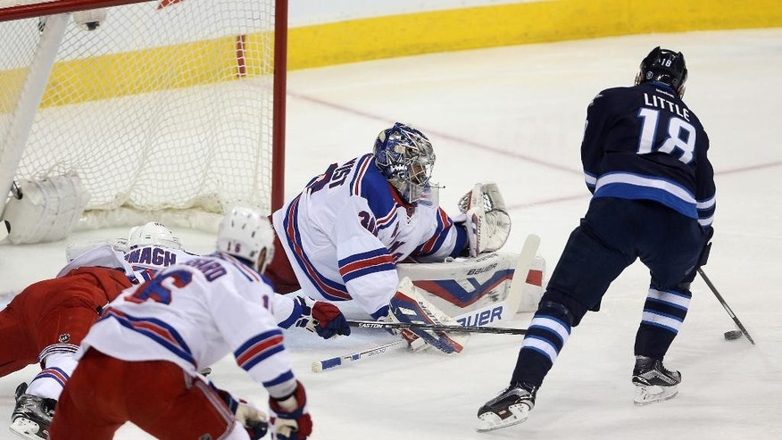 Winnipeg Jets' Bryan Little (18) opens the scoring as he puts the puck past New York Rangers goaltender Henrik Lundqvist (30) during the first period of an NHL hockey game Friday, Dec. 18, 2015, in Winnipeg, Manitoba. (Trevor Hagan/The Canadian Press via AP)