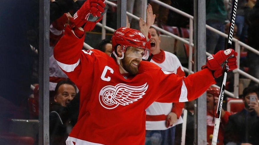 Detroit Red Wings left wing Henrik Zetterberg celebrates his game tying goal against the Vancouver Canucks in the third period of an NHL hockey game Friday, Dec. 18, 2015 in Detroit. (AP Photo/Paul Sancya)