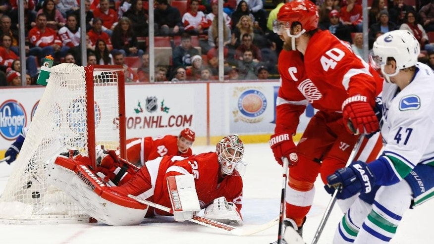 Vancouver Canucks left wing Sven Baertschi (47) watches his shot beat Detroit Red Wings goalie Jimmy Howard (35) in the second period of an NHL hockey game Friday, Dec. 18, 2015 in Detroit. (AP Photo/Paul Sancya)