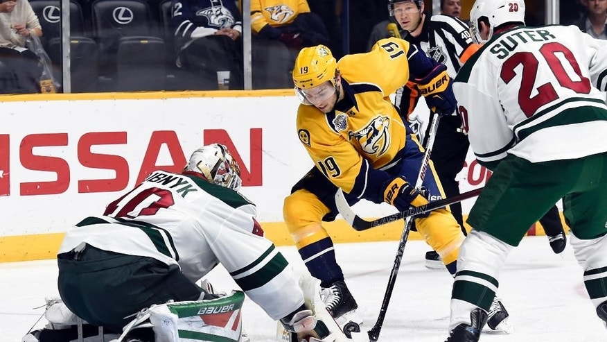 Minnesota Wild goalie Devan Dubnyk (40) blocks a shot by Nashville Predators center Calle Jarnkrok (19),of Sweden, in the second period of an NHL hockey game Saturday, Dec. 19, 2015, in Nashville, Tenn. (AP Photo/Mark Zaleski)