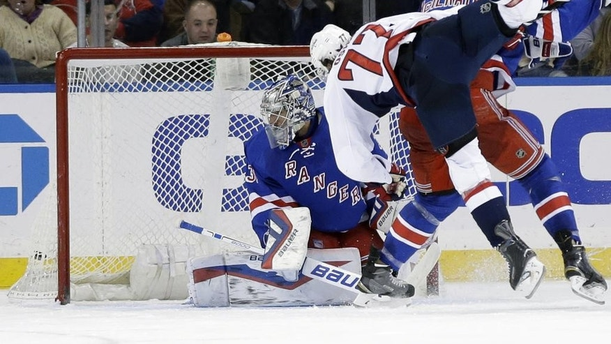 Washington Capitals' T.J. Oshie (77) scores a goal past New York Rangers goalie Henrik Lundqvist, left, during the second period of the NHL hockey game, Sunday, Dec. 20, 2015, in New York. (AP Photo/Seth Wenig)