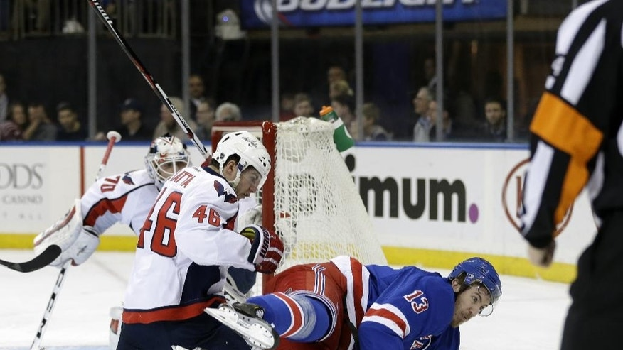 New York Rangers' Kevin Hayes, right, gets tangled up with Washington Capitals' Michael Latta during the second period of the NHL hockey game, Sunday, Dec. 20, 2015, in New York. (AP Photo/Seth Wenig)