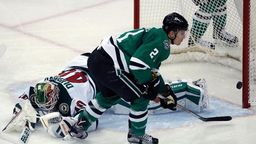 Dallas Stars left wing Antoine Roussel (21), from France, scores a goal past Minnesota Wild goalie Devan Dubnyk (40) in the third period of an NHL hockey game, Monday, Dec. 21, 2015, in St. Paul, Minn. The Stars won 6-3. (AP Photo/Ann Heisenfelt)