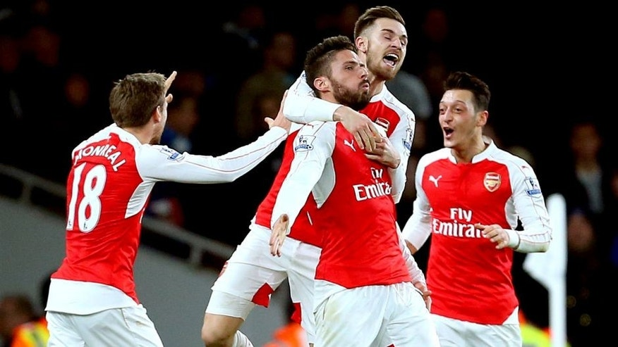 LONDON, ENGLAND - DECEMBER 21: Olivier Giroud of Arsenal celebrates after scoring to make it 2-0 during the Barclays Premier League match between Arsenal and Manchester City at the Emirates Stadium on December 21, 2015 in London, England. (Photo by Catherine Ivill - AMA/Getty Images)