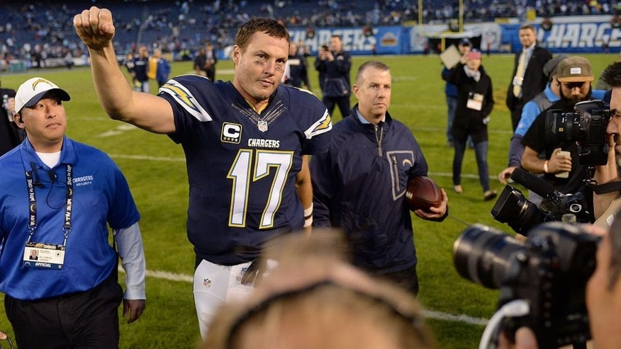Dec 20, 2015; San Diego, CA, USA; San Diego Chargers quarterback Philip Rivers (17) pumps his fist after the Chargers beat the Miami Dolphins 30-14 at Qualcomm Stadium. Mandatory Credit: Jake Roth-USA TODAY Sports