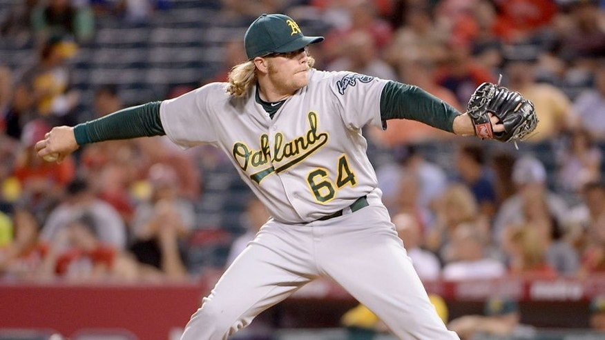 Sep 24, 2013; Anaheim, CA, USA; Oakland Athletics starter A.J. Griffin (64) delivers a pitch against the Los Angeles Angels at Angel Stadium of Anaheim. Mandatory Credit: Kirby Lee-USA TODAY Sports