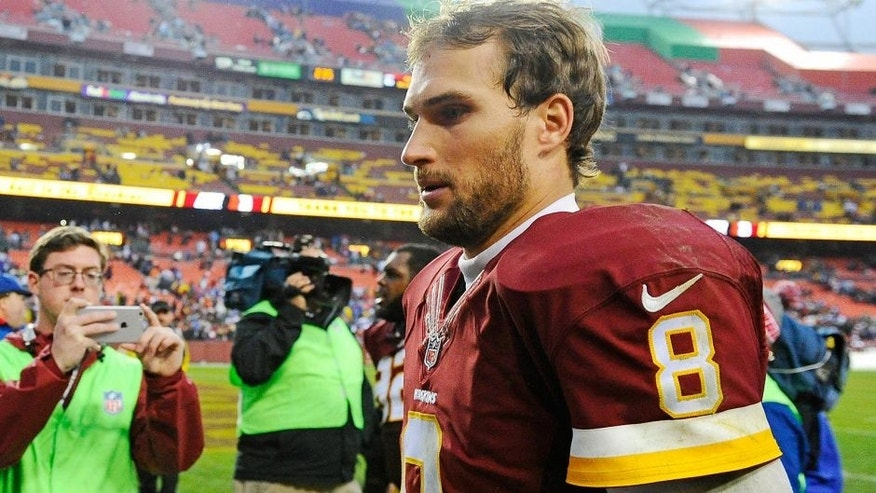 Nov 29, 2015; Landover, MD, USA; Washington Redskins quarterback Kirk Cousins (8) walks of the field after the game against the New York Giants at FedEx Field. The Redskins won 20-14. Mandatory Credit: Brad Mills-USA TODAY Sports
